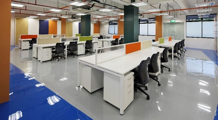 Open office with concrete floors and high ceiling that would be ideal for a modular meeting room
