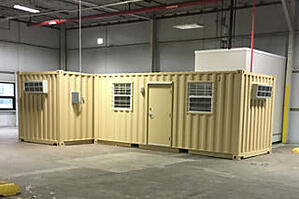 Shipping container office placed inside of a warehouse