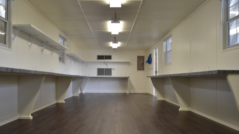 Interior finishes for a mobile container office in a warehouse