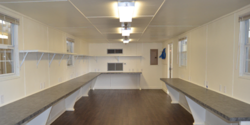 Interior of shipping container modified into a mobile office space.