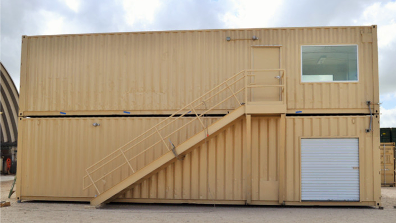 Stacked shipping containers are efficient on warehouse floorspace.