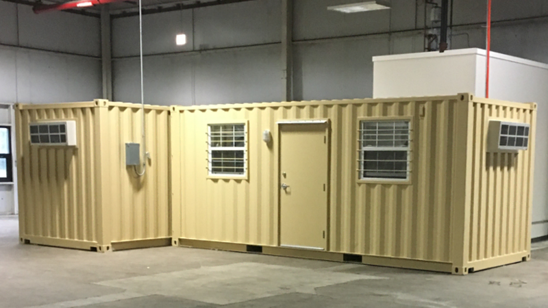 Shipping container offices arranged for warehouse work.