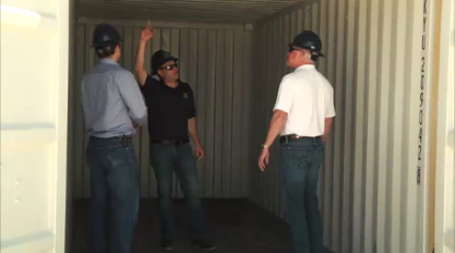Touring interior of one-trip shipping container.