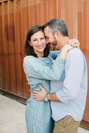 Engagement photo in front of a shipping container