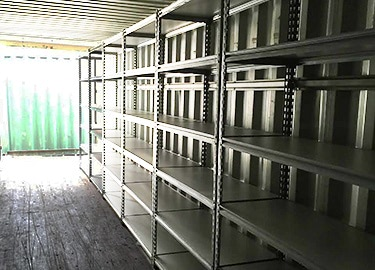 Full shelving on inside of shipping container
