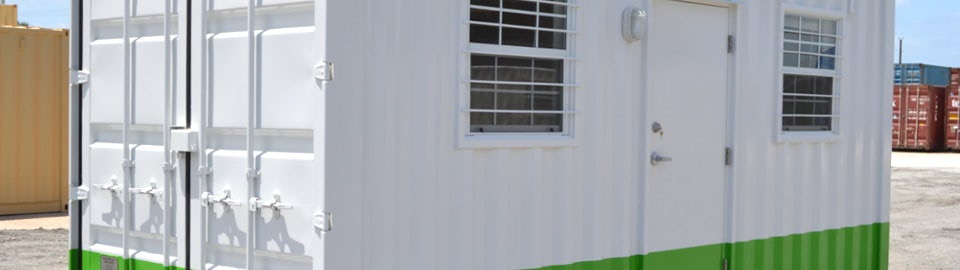 Shipping container modified into mobile sales office.