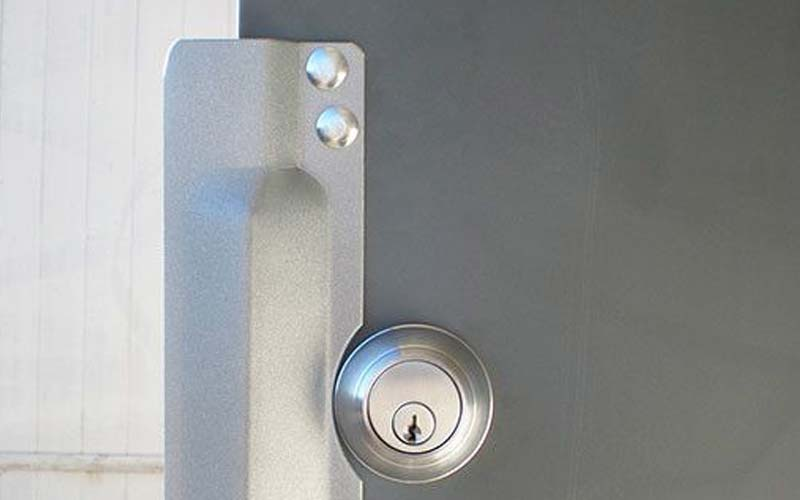 Exterior door with latch protector