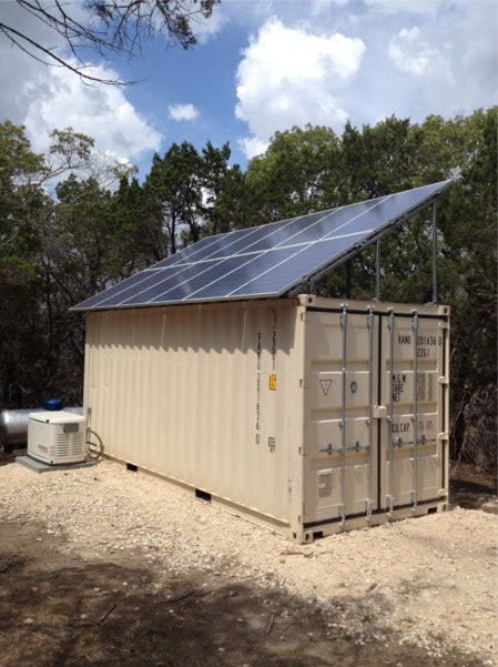 Shipping container structure with large enough solar panels and batteries to power an R.V.