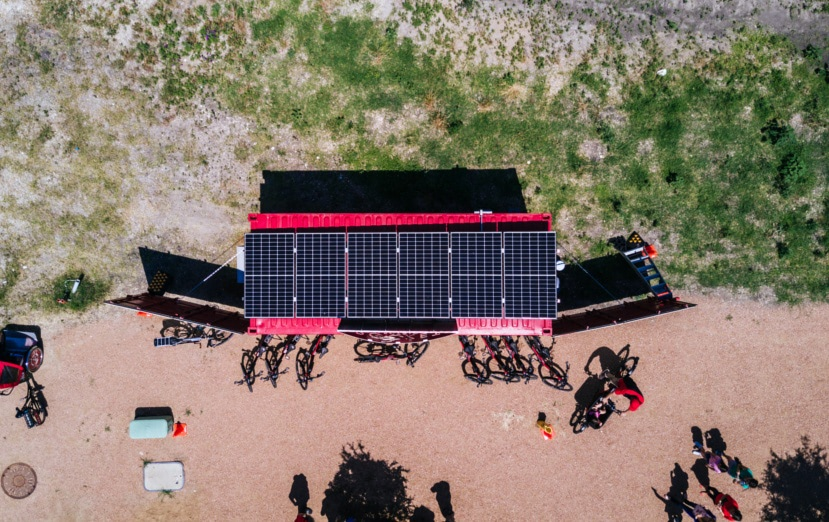 Aerial shot of Rocket Electrics' solar powered shipping container store front.