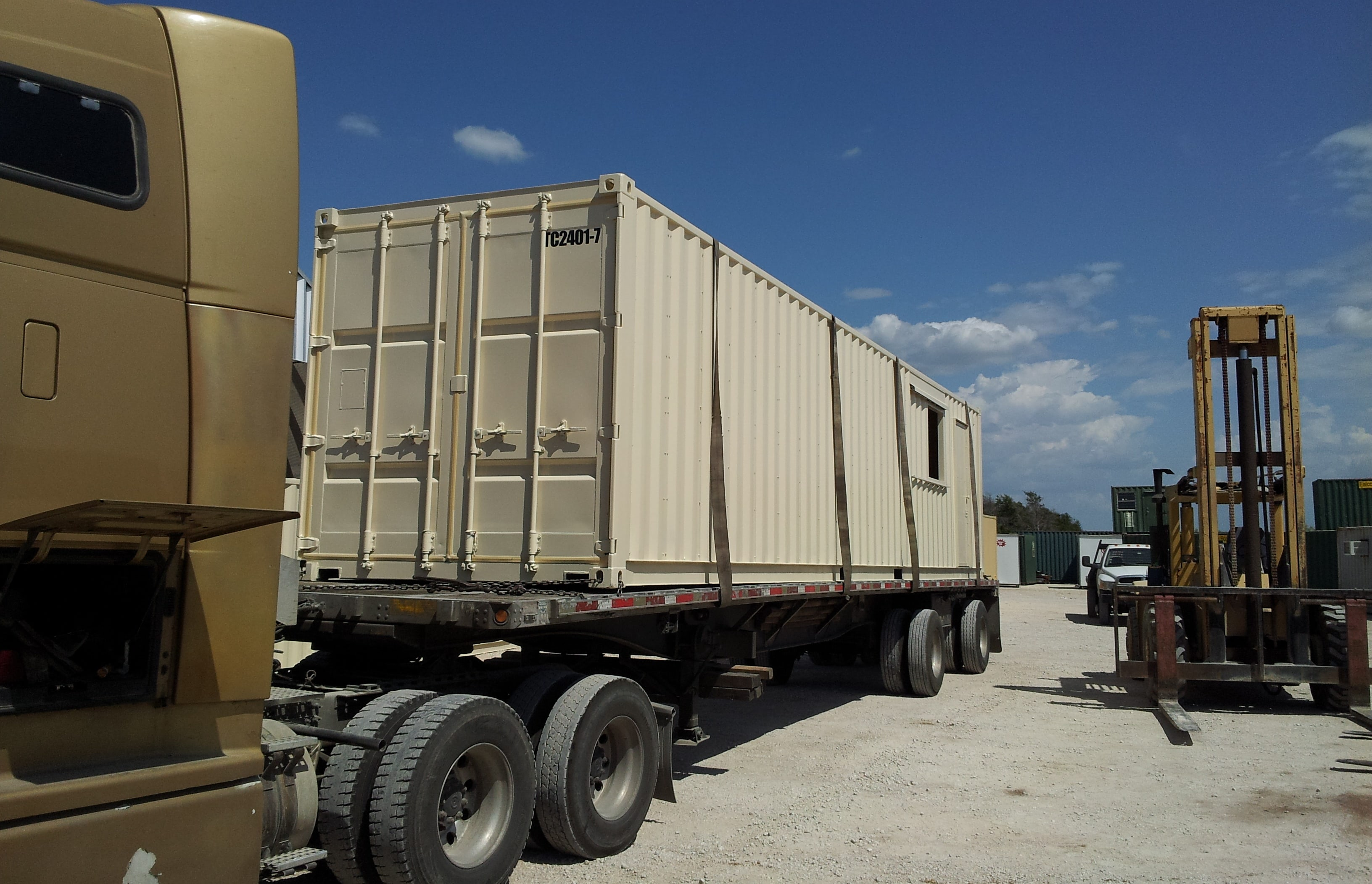 Shipping container on truck ready to be delivered.