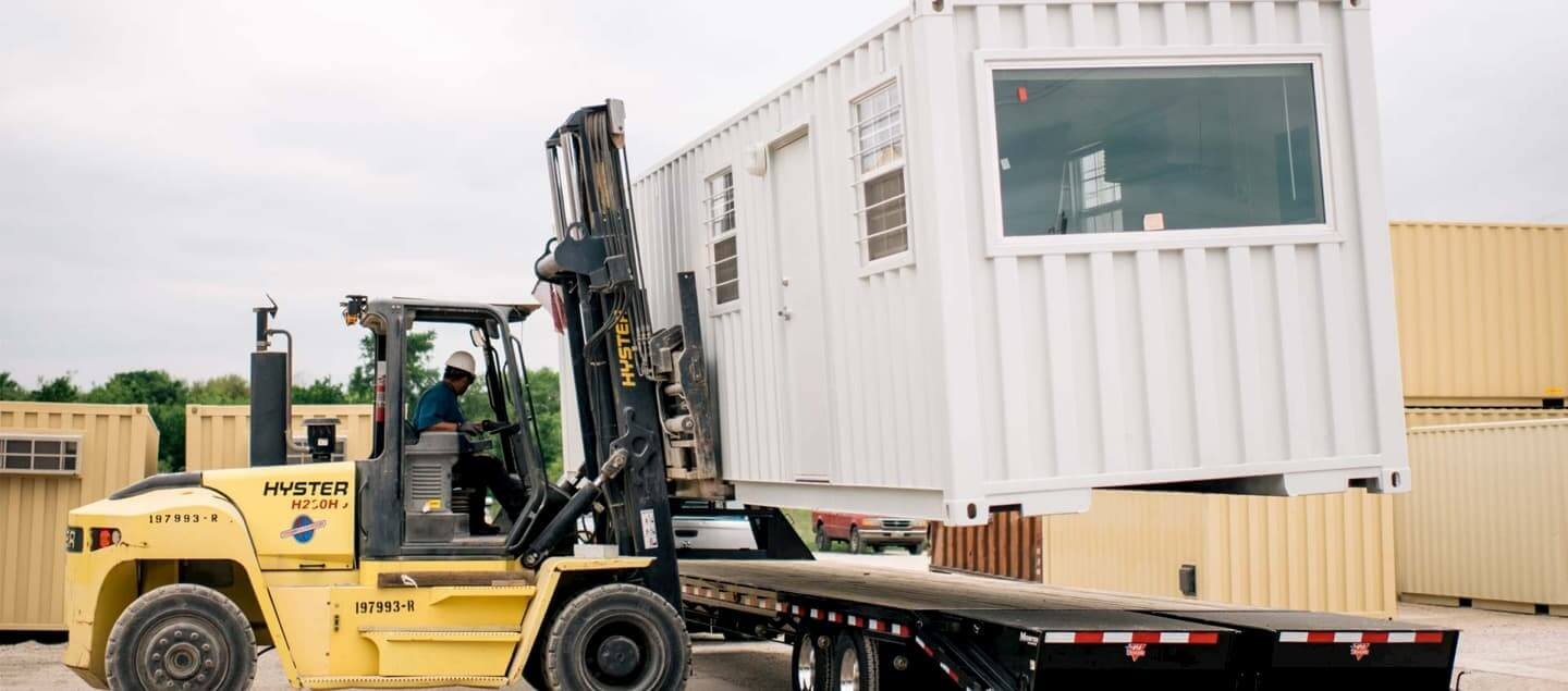 modified-shipping-container-being-moved-by-a-forklift (1)