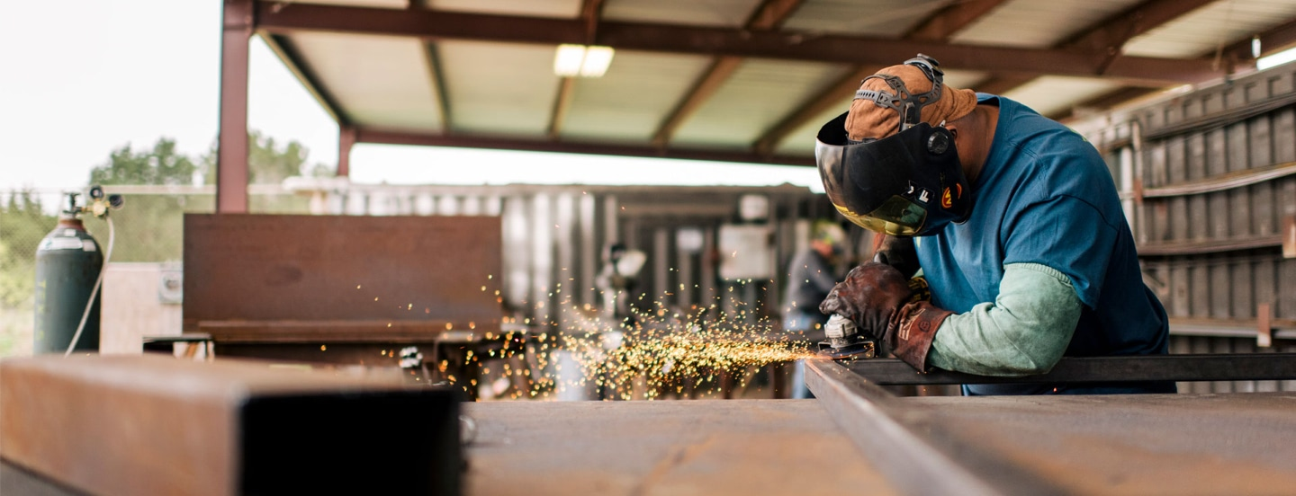 worker-with-grinder-working-on-a-frame-with-sparks