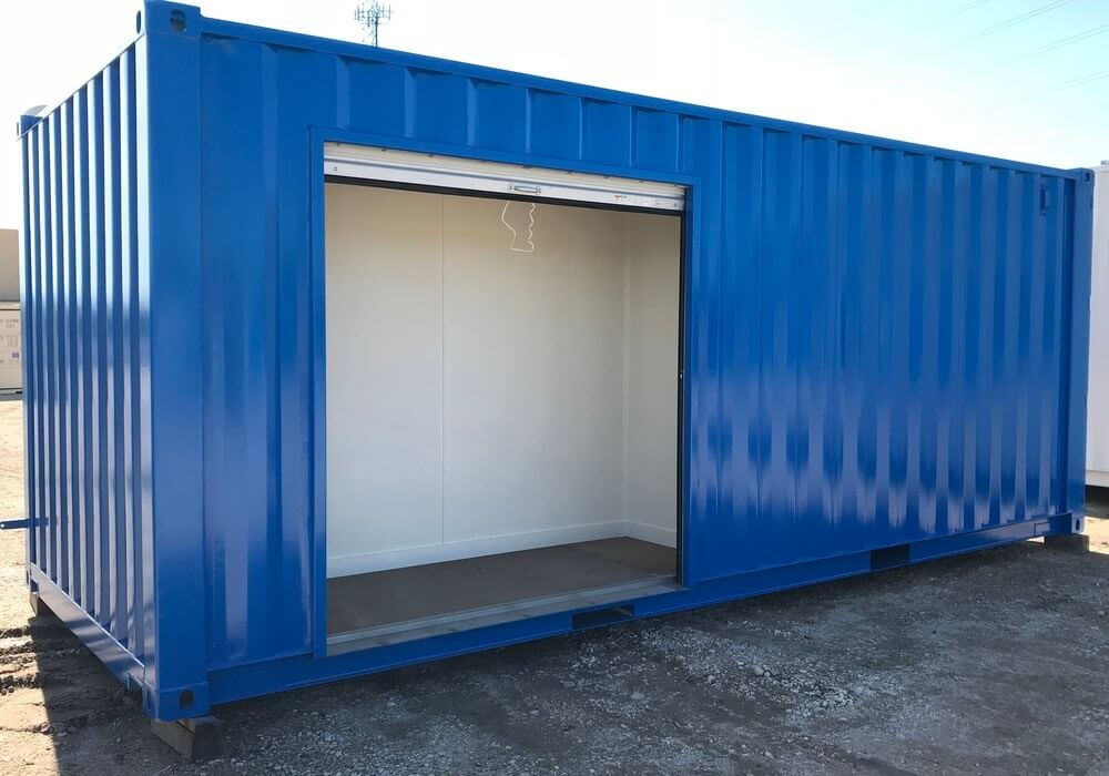 Modified storage container with overhead door