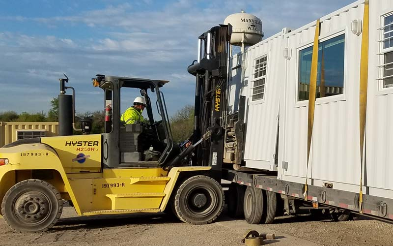 forklift removing container from flatbed