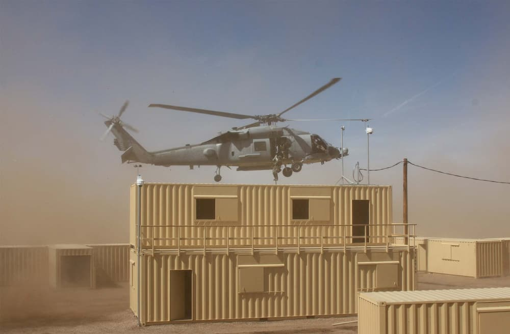 military-helicopter-flying-over-multi-container