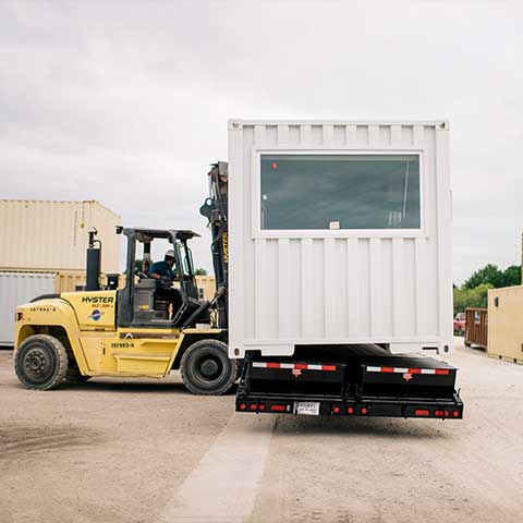 forklift_moving_office_container