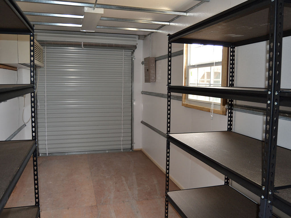 Interior of a modified storage container with shelving
