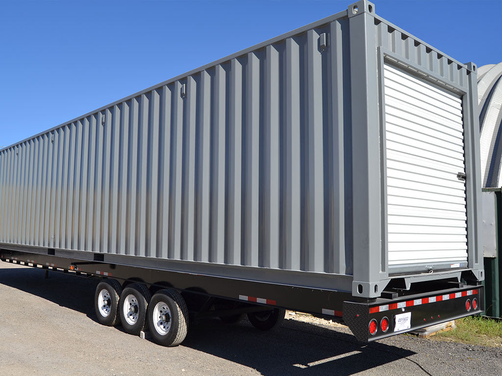 Storage container with overhead door on trailer