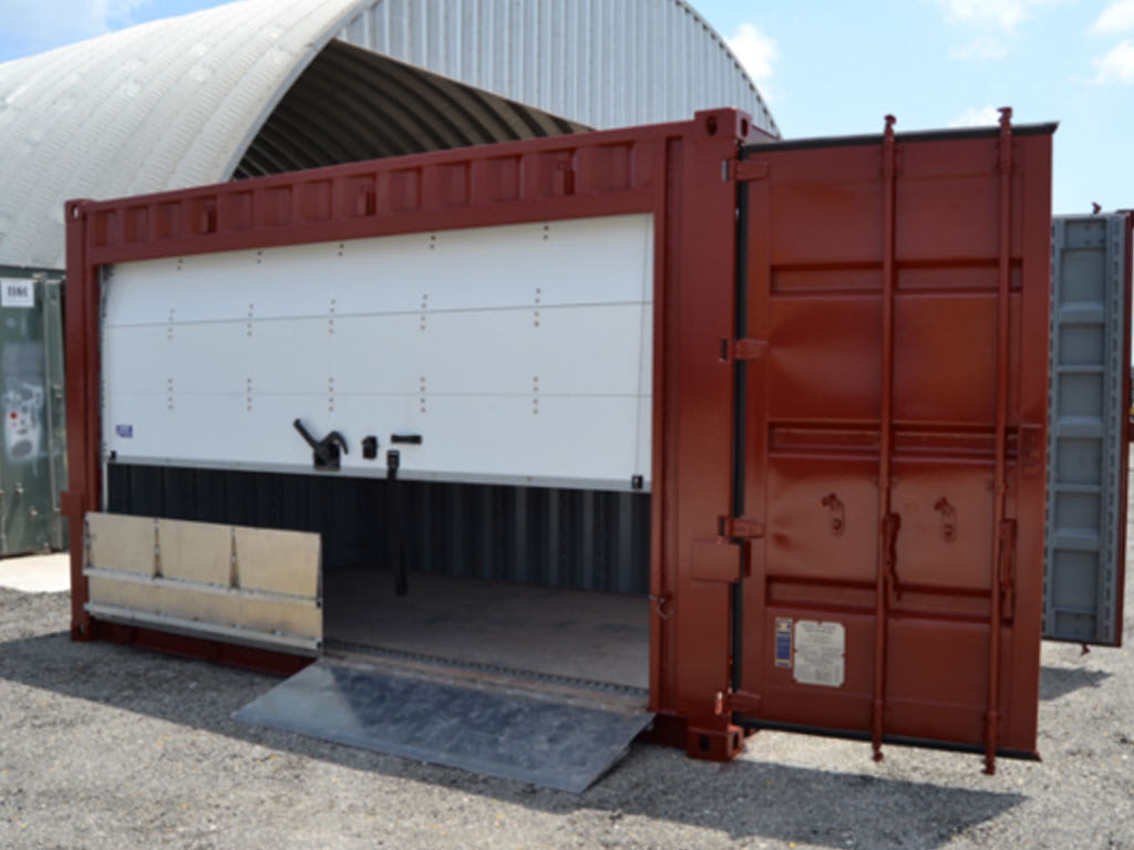 Storage container with garage door opening and ramps