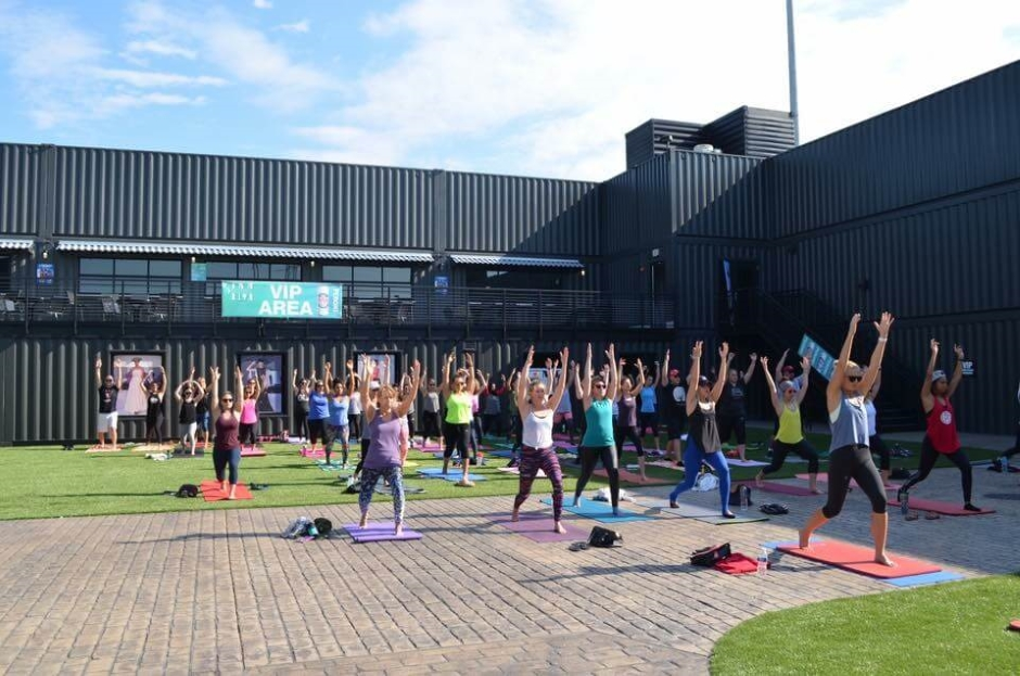 yoga class inside a shipping container sports stadium