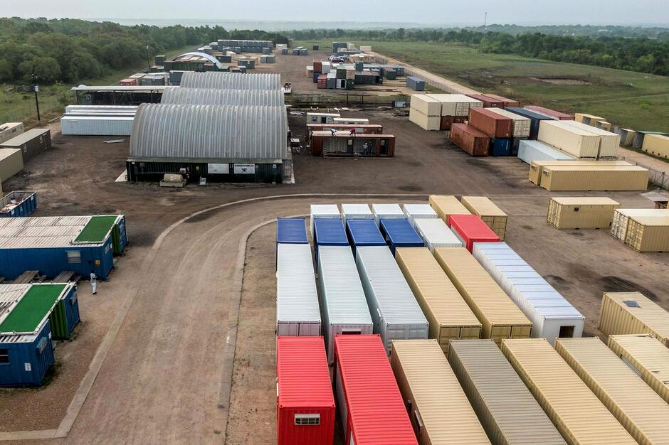 many modified shipping containers on a manufacturing site