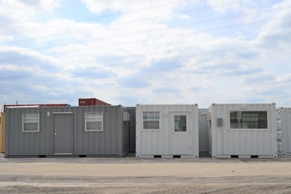 one 20-foot gray shipping container office two white 10-foot shipping container offices