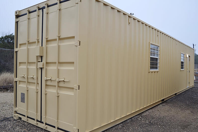 exterior of portable office storage container with two windows and one door
