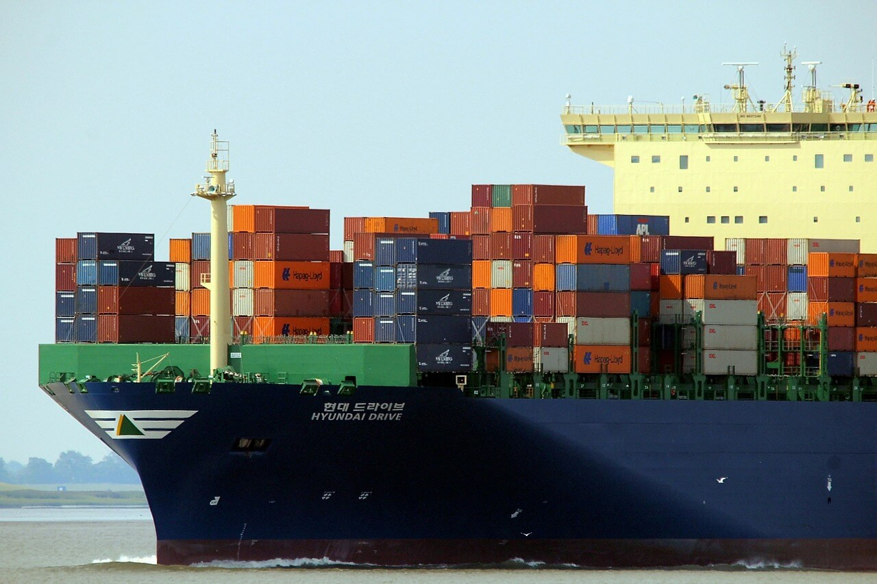 shipping containers being transported by a cargo ship