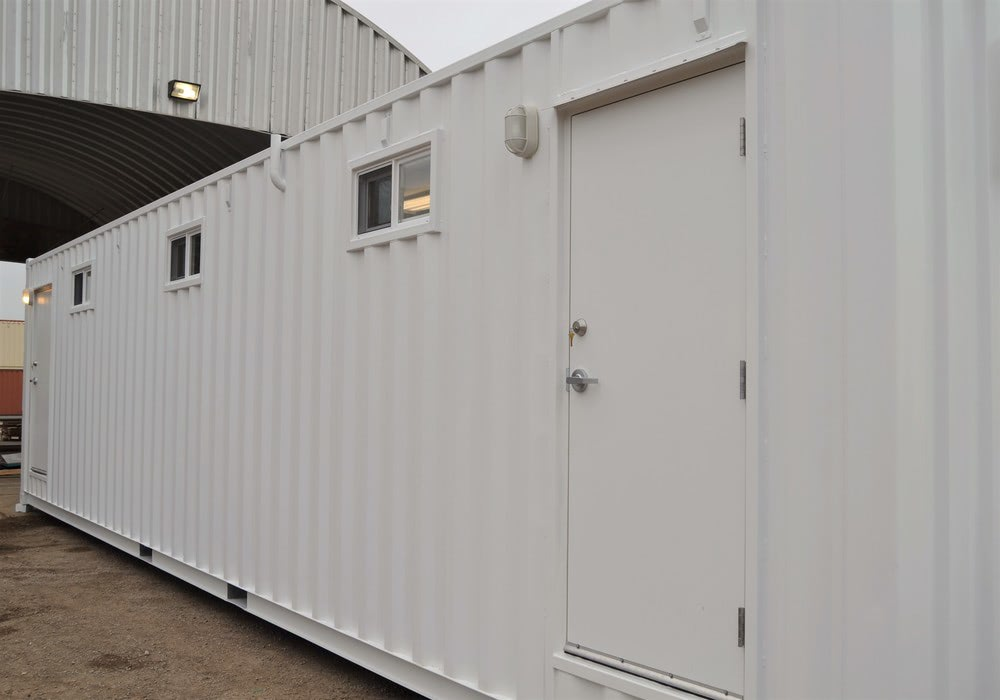 40-foot shipping container bathroom with two doors and three privacy windows