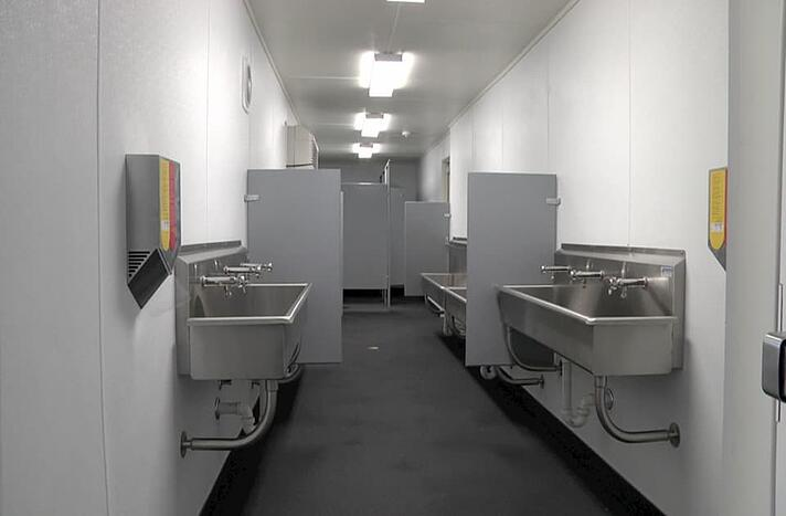 custom modification shipping container bathroom design with metal sinks and stalls
