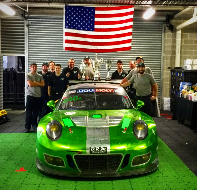 Black Swan Racing with their trophies and iconic green Porsche.