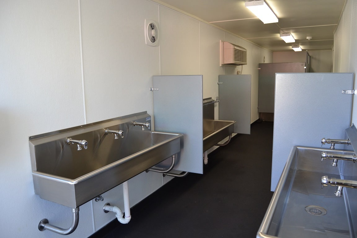 Interior of an oilfield restroom building built in a shipping container.