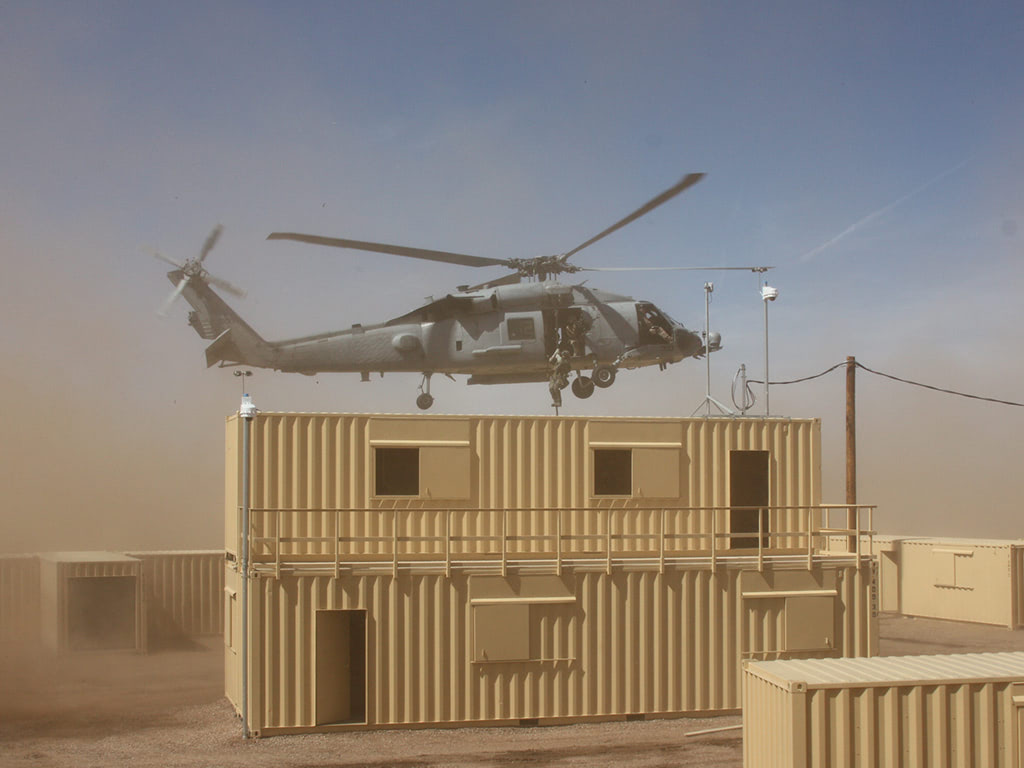 Fast rope descent into military training container village