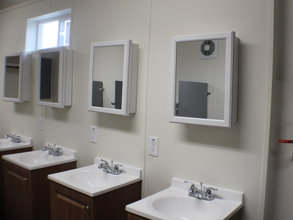 Bathroom interior with sinks and vanity mirrors