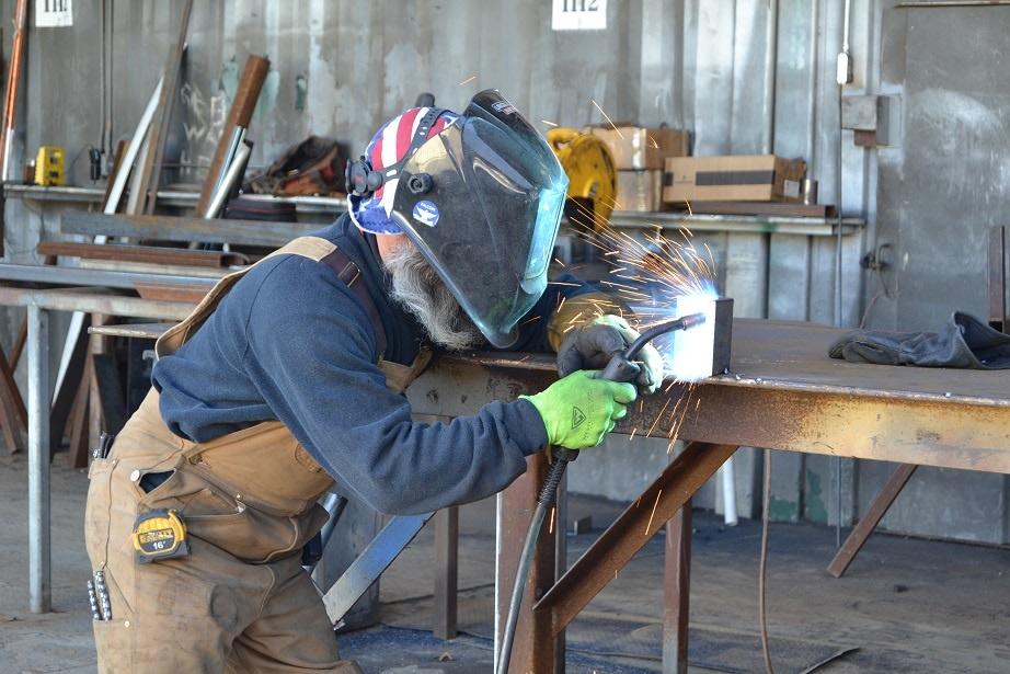 Production team member welding.