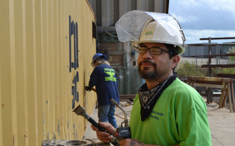 Production team member preps shipping container.