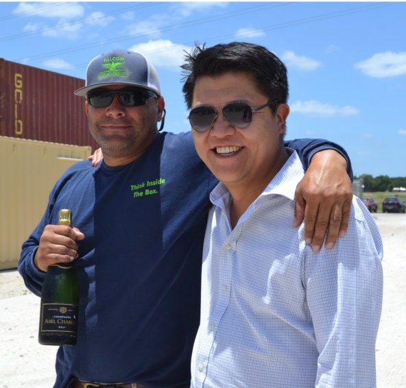 Falcon Structures' co-founder, Stephen Shang, and production manger, Anthony Moreno, celebrate.