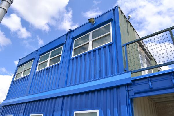 Shipping container two-story office building