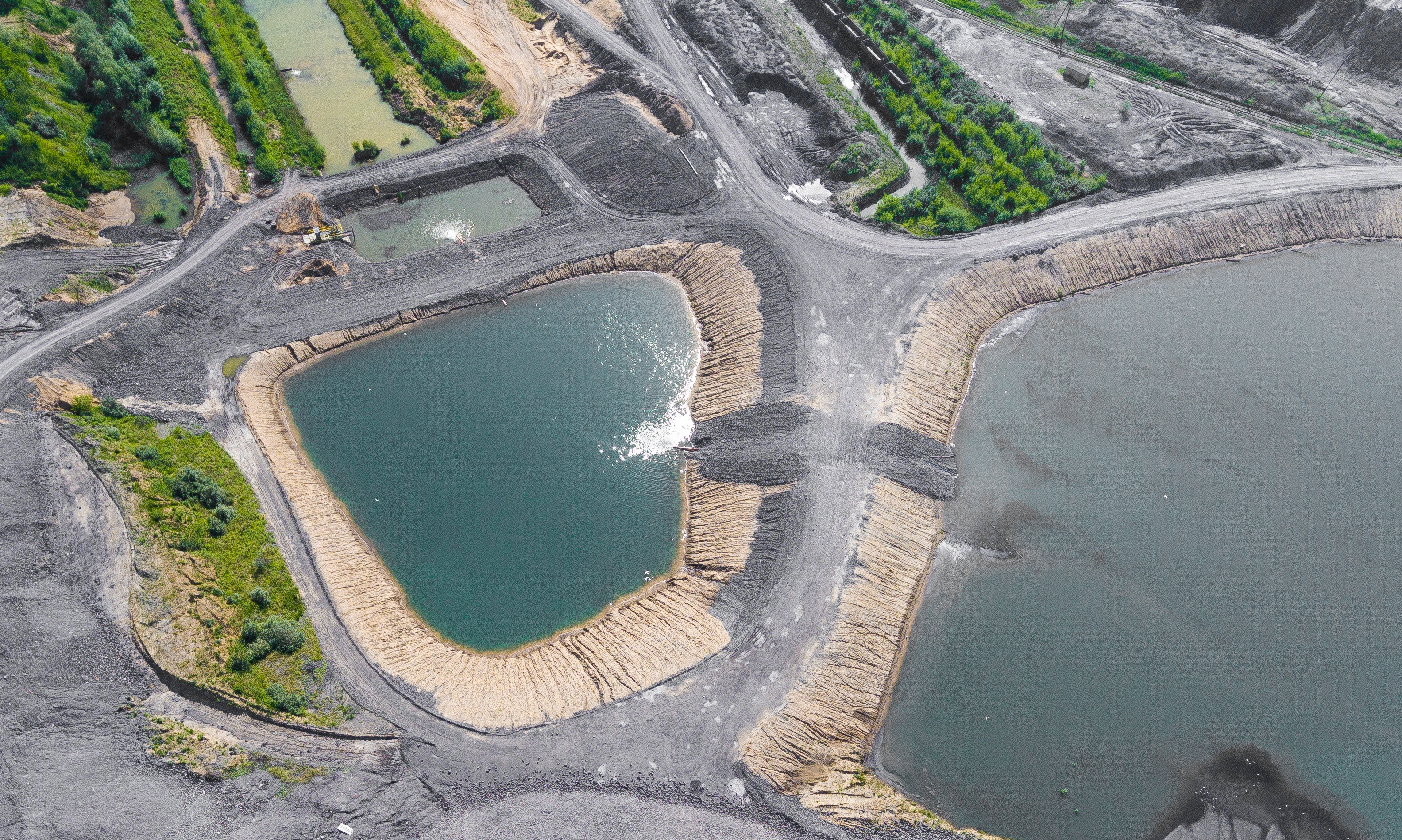 Aerial view of coal ash ponds. Licensed under iStock.