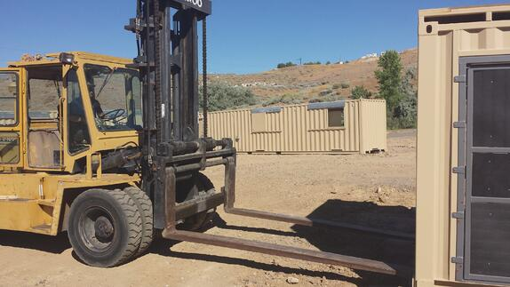 Forklift pockets make installing the containers that will form a first responder training structure, fast and easy.