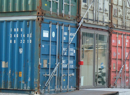 Rust on edges of shipping containers used in retail structure. Freita shop entrance, Denna Jones, 2006. CC-BY-2.0.