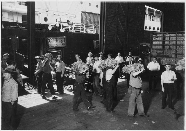 Historic image of longshoremen carrying cargo before shipping containers came into commercial use