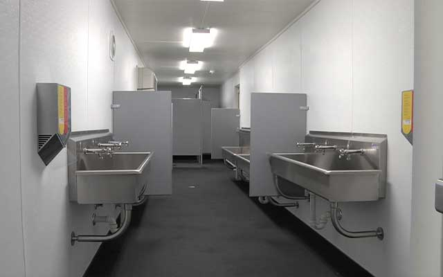 container_bathroom_with_sinks_and_stalls